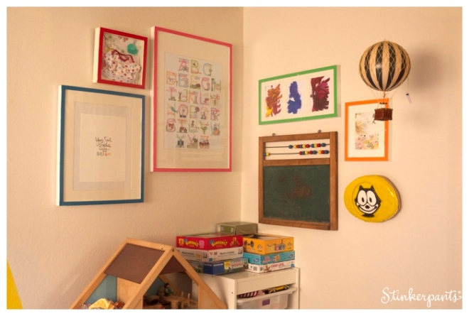 Colorful gallery wall in a kids room