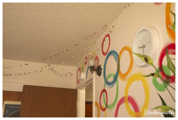 hand painted wall in a kids' room with star garlands