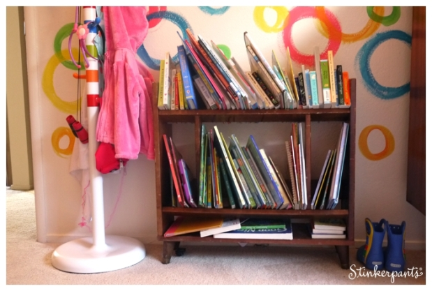 bookshelf in a colorful hand painted circle wall