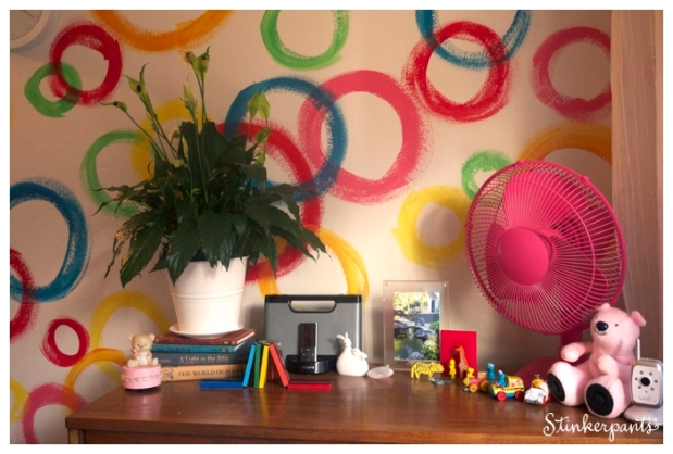 Hand painted colorful circles in a kid's room