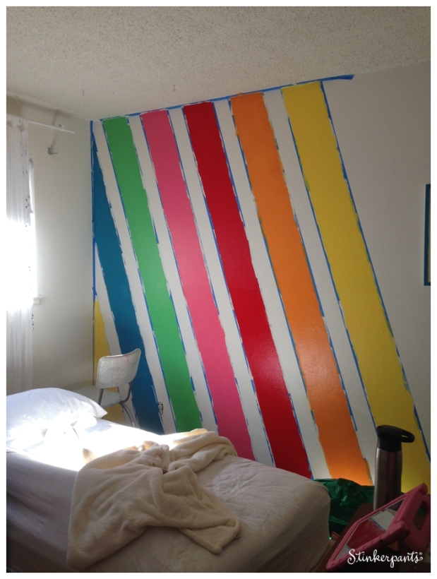 DIY diagonal stripes in a kids room using painter's tape and paint samples